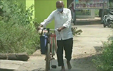 87-Year old Doctor travels 10 km barefoot daily on Bicycle to treat villagers amid COVID-19
