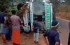 Tourist bus overturns at Peradka, passengers suffer minor injuries