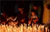 Citizens light candles for the slain