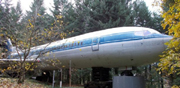 He turns an old plane into a house. See when you opens the door in the interior