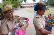 Assam police officers take care of babies while their mothers write TET exam