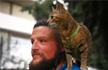 Meet the man who is biking around the world, with a cat on his back