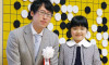 Go-getter: Japanese girl, nine, becomes strategy game�s youngest professional