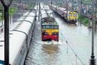 Mumbai rains hit rail, road traffic, cause landslide
